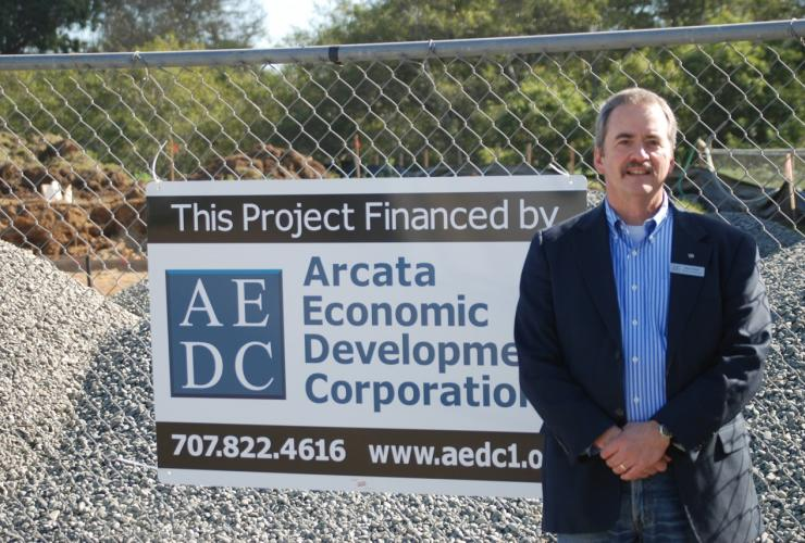 Ross Welch on location with AEDC sign